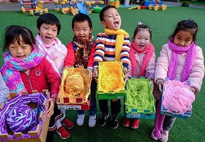 Colorful scarves made by kindergarten children to be sent to Tibet as gifts